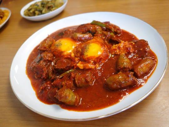 Ajja Merguez with Merguez sausage, eggs, tomato and
