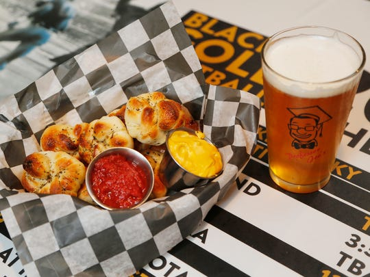 Garlic knots with marinara and cheese dipping sauce along with a pint of Daredevil Lift Off IPA Wednesday, March 1, 2017, at Professor Joe's Sports Pub & Pizzeria, 648 Main Street in downtown Lafayette.