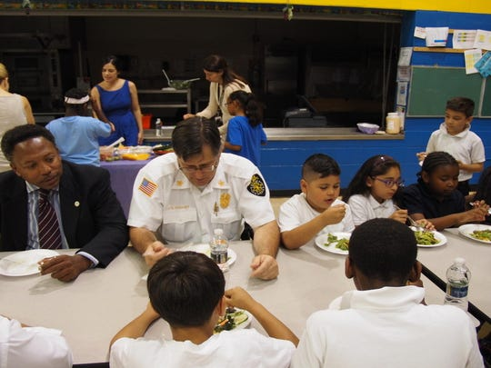 "Linden Mayor Derek Armstead, Linden Fire Chief Josheph Dooley and Nicholas Herrera, Aylin Acosta and Aamira Williams eat their ""Friendship Salad"" together."