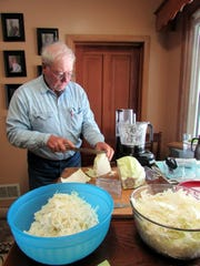 Bob helps make sauerkraut.