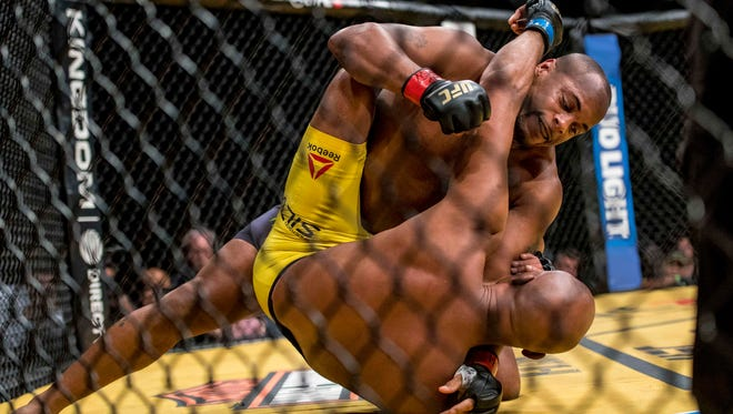 Daniel Cormier, top, punches Anderson Silva at UFC 200 in Las Vegas.