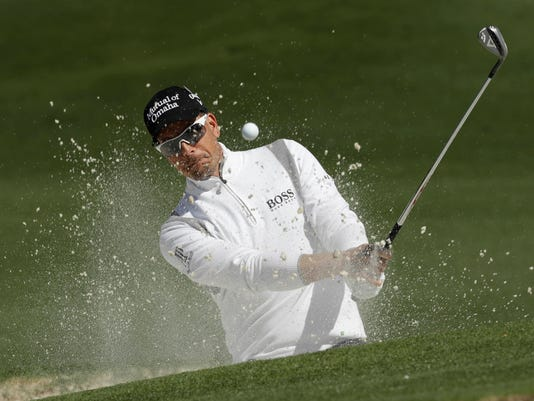 Henrik Stenson of Sweden, hits from a bunker on the seventh hole during the second round of the Masters golf tournament Friday, April 7, 2017, in Augusta, Ga. (AP Photo/David J. Phillip)