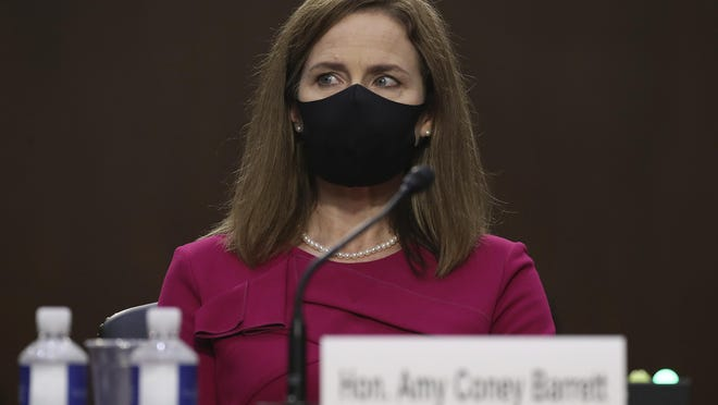 Supreme Court nominee Amy Coney Barrett listens during her confirmation hearing at the Senate Judiciary Committee on Capitol Hill in Washington, Monday, Oct. 12, 2020.