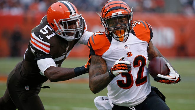 Bengals running back Jeremy Hill carries the ball against the Browns on Sunday.