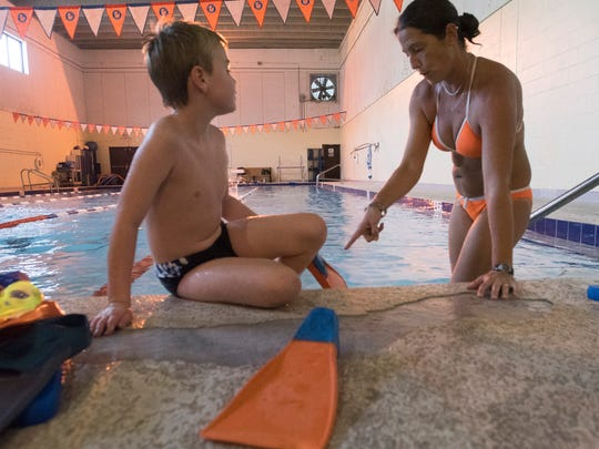SEASTAR Executive Director and coach, Robin Heller, prepares Jake Wales, 10, for swim practice Thursday, Sept 21, 2017. SEASTARS is an aquatics program dedicated to providing year-long swimming activities to special needs and low-income children.