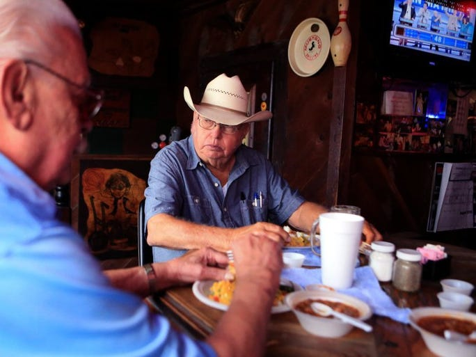 Butch Bowen (left) and Henry Albers eat lunch at Lou's Landmark Saloon on Tuesday, Aug. 30, 2016. Bowen has been going to the saloon since 1965 and Albers since 1969.