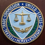 File photo shows the logo of the Federal Trade Commission on a lectern in the consumer-protection agency's headquarters.