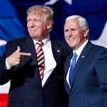 Republican presidential candidate Donald Trump joins Republican vice presidential candidate Indiana Gov. Mike Pence after Pence's acceptance speech during the third day session of the Republican National Convention in Cleveland, Wednesday, July 20, 2016.