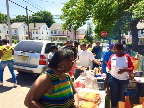 Friends and family of the late Jerame C. Reid mark