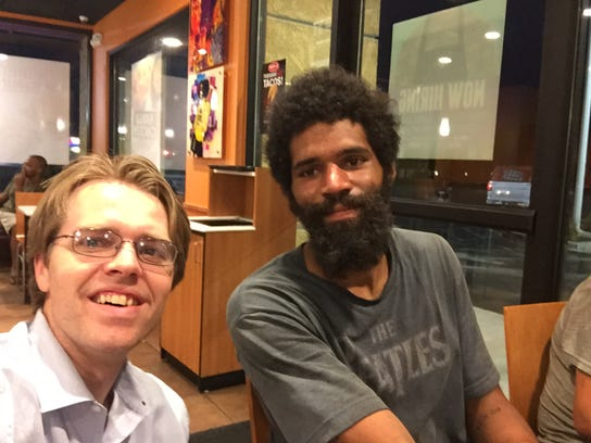 Nathaniel Gee eats dinner with Tony in Sacramento. Tony was once a cook. Now, after a jail conviction, he is unable to find a job and lives on the streets.