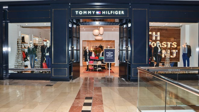 The Tommy Hilfiger store located at Garden State Plaza in Paramus when it opened in 2013. Though Tommy Hilfiger's same-store sales plunged 11 percent in North America during the most recently reported quarter, e-commerce has emerged as its biggest source of growth. The business is increasingly relying on social media to target millennials and reinvigorate a brand that's closely linked to the '90s.