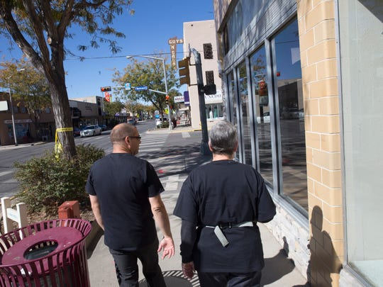 Identity Inc. board member MP Schildmeyer and staff member Dale Leedy visit local stores along west West Main Street in Farmington on Tuesday to inform them about the upcoming local Pride parade .
