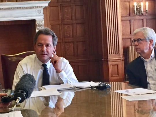 Gov. Steve Bullock, left, talks recently about the state budget as Lt. Gov. Mike Cooney looks on.
