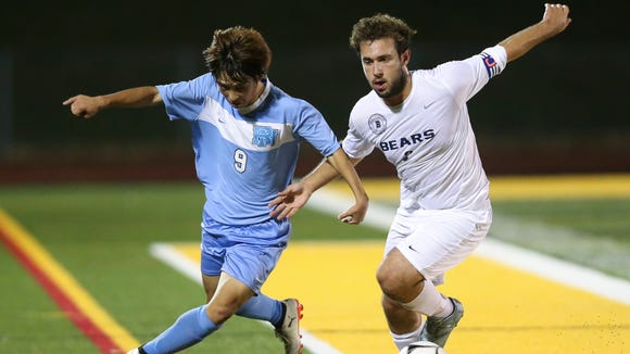 Rye Neck's Dan Fujiwara (9) and Briarcliff's John Gross (3) battle for possession during the boys Class B soccer finals at Lakeland High School in Shrub Oak on Saturday, October 28, 2017.