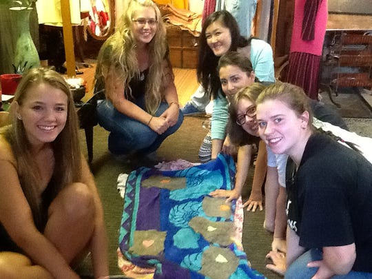 Left to right: Senior Mary Baldwin Business Administration majors Sarah Norfolk, Megan Stroop, Carolyn Huynh, Yenny Hevener, Shelvey Smith and Kayla Sibold get hands-on experience in sustainable business practices in Jacenich's studio at Artful Gifts.