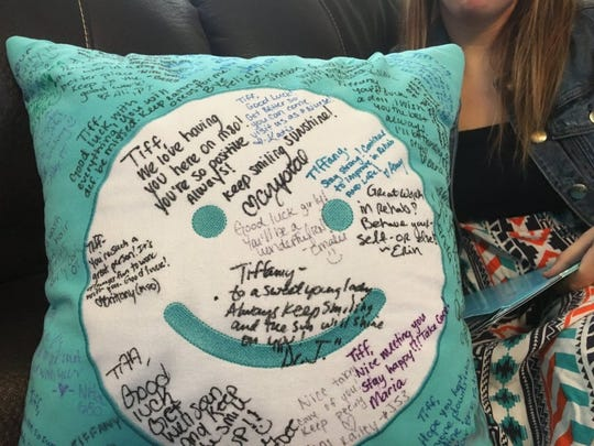 """Doctors and staff at the Cleveland Clinic in Ohio presented Russell a pillow with personal messages upon her discharge Sept. 15 from the facility. The other side of the pillow bears the message, """"Always look on the bright side."""""""