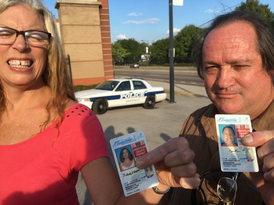 Kimberly Bergeron and her husband, Raymond, on Sept. 13, 2016, display their Tennessee handgun carry permits outside the Tennessee Valley Fair, where guns are banned by order of Knoxville Mayor Madeline Rogero.