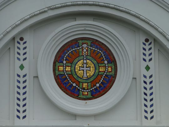 A stained-glass window at the entrance of Holy Rosary