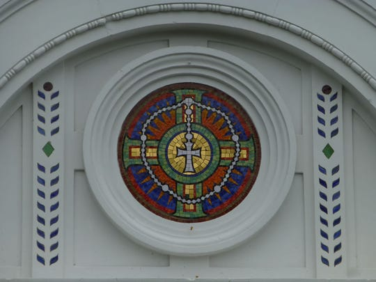 A stained-glass window at the entrance of Holy Rosary Church.