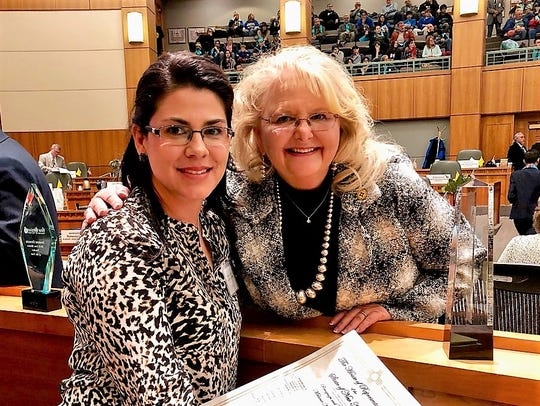 Rep. Candie Sweetser (D-Deming), right, honored Deming Intermediate School teacher Melanie Alfaro (at left) in January, during this year's state legislative session.
