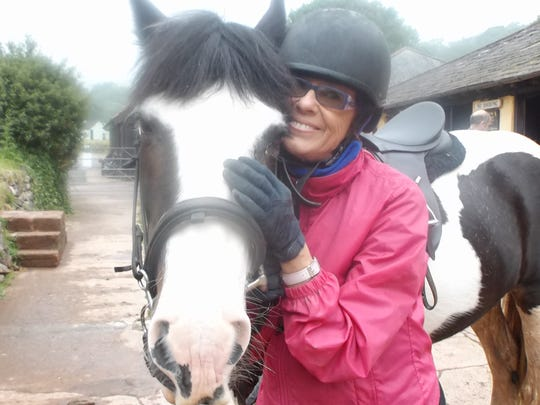 Yvonne and Wendy, her surefooted Cob horse, have a tender moment at the end of a thrilling gallop in fantasy-like Exmoor National Forest.