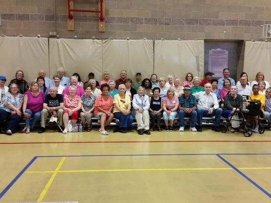 Participants gather for the closing ceremonies for Older Americans Month.