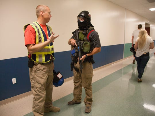 Feedback and talking through the process was part of the active shooter training held in St. George on June 6, 2018.