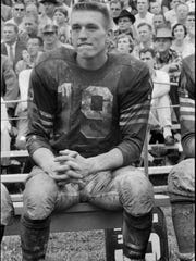 A young Johnny Unitas sat on the bench after seeing action in the Baltimore Colts vs Chicago Cardinals game at Fairgrounds Stadium, in Louisville. Unitas played collage ball at the University of Louisville. By Gean Baron, The Courier-Journal. Sept. 15, 1957