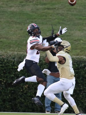 Gardner-Webb wide receiver Izaiah Gathings goes up for a ball as a Wofford defensive back contests.