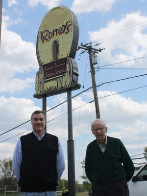 David Loftspring (left) and his father, Allen Loftspring, stand in front of the old Roney's sign in this 2012 photo.