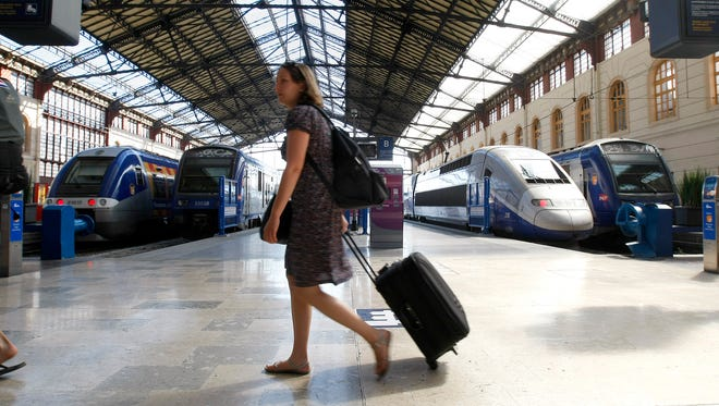 A passenger walks in Saint-Charles railway station in Marseille, southern France, in June