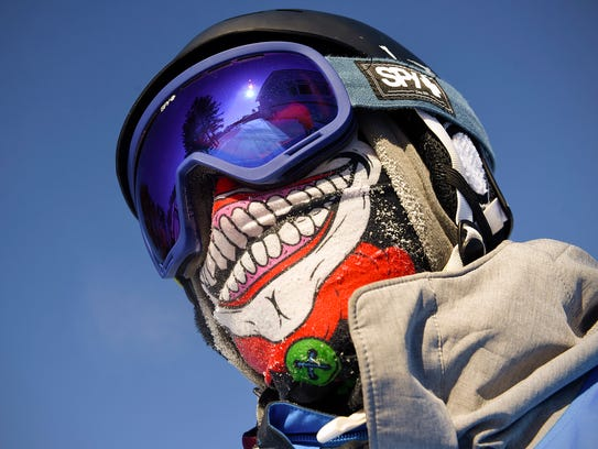 Thomas Reiswig, 18, Albertville, watches other skiers