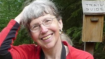 This undated photo provided by Lola Kemp shows Karen Sykes. Crews searched Mount Rainier National Park on Friday, June 20, 2014, for Sykes, an outdoors writer, was reported missing late Wednesday while she researched a story.