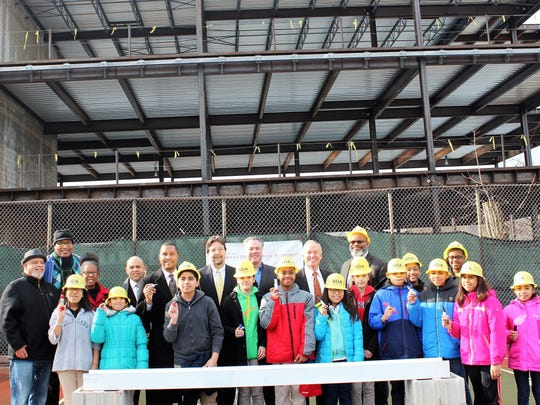 New Jersey Schools Development Authority (SDA) CEO Charles McKenna joined New Brunswick students and local officials for a beam-signing ceremony to highlight the progress of construction on the addition and renovation project at the Paul Robeson Community Theme School for the Arts in New Brunswick.
