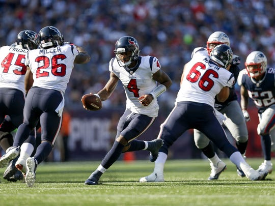 Sep 24, 2017; Foxborough, MA, USA; Houston Texans quarterback Deshaun Watson (4) fakes a hand off to running back Lamar Miller (26) during the second half against the New England Patriots at Gillette Stadium.