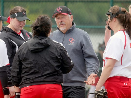 Former Olympic College softball coach Chuck Stark was hired to coach the sport at Olympic High School this spring.