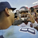 Tampa Bay Buccaneers quarterback Jameis Winston, right, congratulates Tennessee Titans quarterback Marcus Mariota after the Titans defeated the Buccaneers 42-14 during an NFL football game Sunday, Sept. 13, 2015, in Tampa, Fla. (AP Photo/Chris O'Meara)