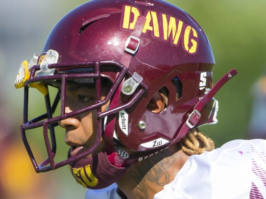 ASU defensive back Joey Bryant warms up during practice