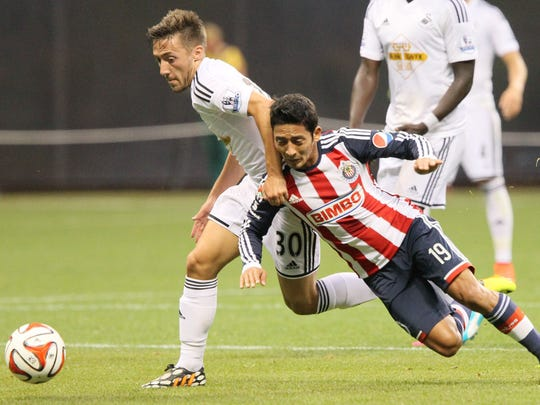 Swansea's Josh Sheehan (left) and Chiva's David Toledo battle for control of the ball during the two teams' match at Miller Park in 2014.