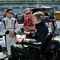 Owner Sam Schmidt (R) discusses Carb Day practice with Simon Pagenaud and crew at the Indianapolis Motor Speedway on May 23, 2014.