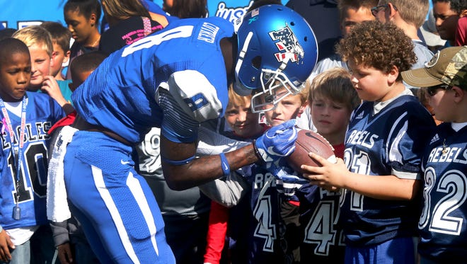 MTSU's Jeremy Cutrer (8) signs a football for a young fan before the UTSA game Nov. 5, 2016.