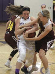 Indianola junior Haley Vesey fights for the ball with Ankeny freshman Sara McCullough. Class 5-A fifth-ranked Indianola beat Ankeny 52-47 in Indianola on Dec. 15.