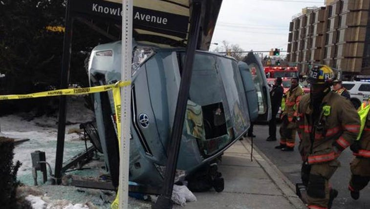 Two pedestrians struck while waiting on the bus in