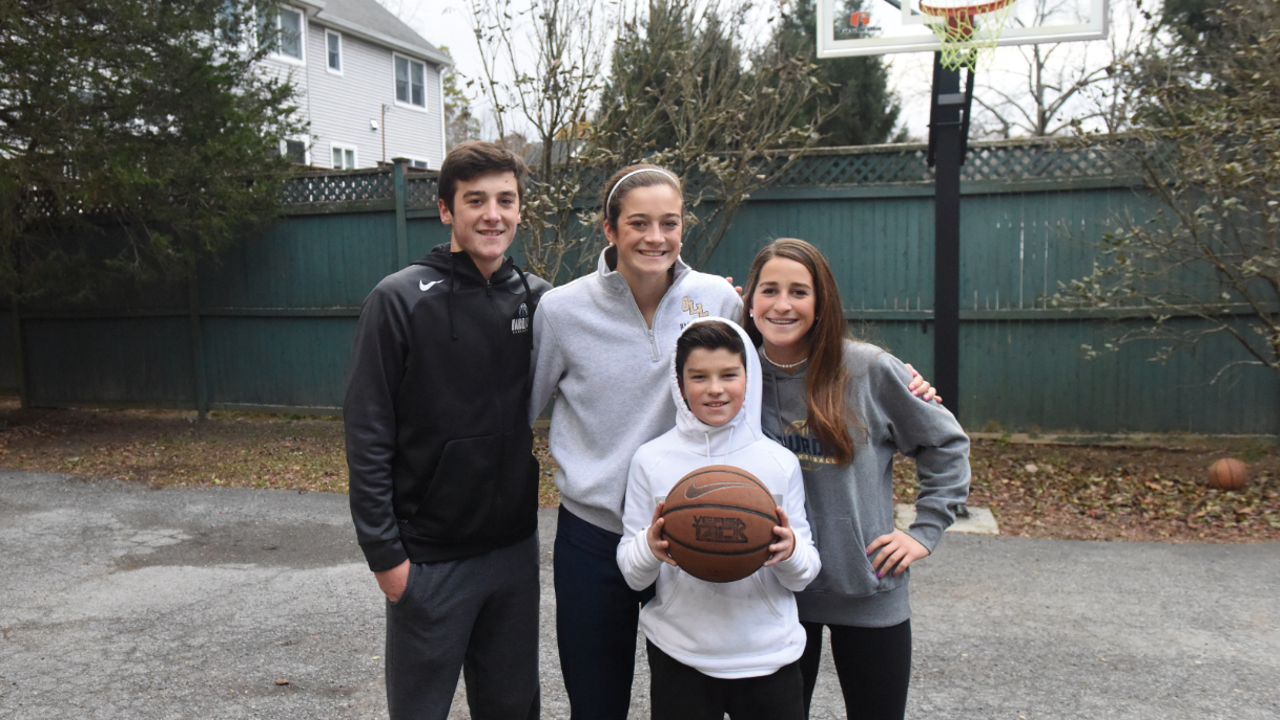 Siblings Maddy, George, Caroline and Patrick Siegrist play a friendly pickup basketball game and H-O-R-S-E in the driveway of their Poughkeepsie home.