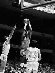 Vanderbilt center John Sneed (32) attempts a shot between