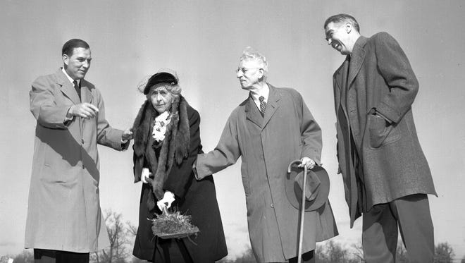 With the assistance of her son, Lee Mallory (left) and Dr. Charles E. Diehl (second right), the president emeritus of Southwestern, Mrs. Daisy Neely Mallory, turned a spadeful of earth on Jan. 6, 1953, to signal the start of construction of Southwestern's new gymnasium. It will be named the William Neely Mallory Memorial Gymnasium in honor of her son, killed in World War II.  Watching the groundbreaking is Dr. Peyton N. Rhodes (right), president of Southwestern. In 1984, the college's name was changed to Rhodes College to honor former college president.
