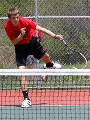 SPASH's Jon Peck plays on a single boys tennis game
