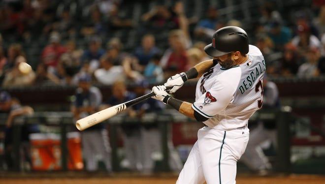 Arizona Diamondbacks third baseman Daniel Descalso (3) hits a solo home run against the San Diego Padres at Chase Field in Phoenix, Ariz. April 25, 2017.