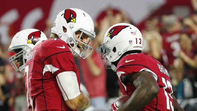 Arizona Cardinals quarterback Blaine Gabbert (left) celebrates with wide receiver Jaron Brown (13).