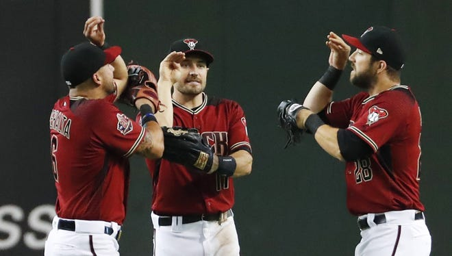Arizona Diamondbacks outfielders David Peralta (left), A.J. Pollock (center) and Steven Souza Jr. (28) celebrate after beating the Houston Astros 3-1 at Chase Field in Phoenix, Ariz. May 6, 2018.